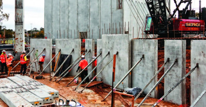 Theatre walls being erected in the foreground and studio walls standing tall in the background.