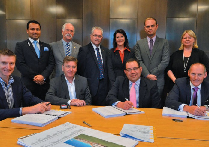 City of Casey Councillors joined Mayor Cr Sam Aziz, CEO Mike Tyler and Brookfield Multiplex Regional Director Ross Snowball and Managing Director Graham Cottam to sign the contract to get construction started.